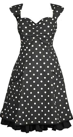 Norah - Black. DRESS IN ORGANIC COTTON. The dress is named after the great singer Norah Jones. It is inspired by 50s pinup and Mad Men style, this knee-length dress is made from 100% organic cotton [GOTS-certified] with polka-dots. The elasticated panel at the back and side zipper provide flexibility. The dress has pockets and it is lined with a very comfortable bamboo-silk.