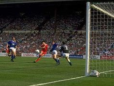 Liverpool 3 - 2 Everton (FA Cup final, 1989). Ian Rush of Liverpool beats goalkeeper Neville Southall of Everton to score their second goal during the 1989 FA Cup final at Wembley Stadium in London.