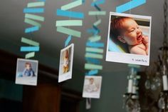 Love this idea of hanging photos taken over baby's 1st year at their 1st birthday party!