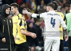 Sergio Ramos of Real Madrid and Emre Mor of Borussia Dortmund are seen during the UEFA Champions League Group F football match between Real Madrid...