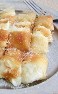 Bougatsa is a Greek pastry that ranks among the highest of any treats we've tried the world over. So next time you find yourself in Greece, try it! Greek Sweets, Greek Desserts, Greek Recipes, Cookbook Recipes, Cake Recipes, Cooking Recipes, Bougatsa Recipe, Food Network Recipes, Food Processor Recipes