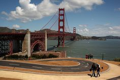 Visitors walk on the newly constructed walking path and bicycle trail near the Golden Gate Bridge in San Francisco, California May 25, 2012. The iconic landmark observed its 75th anniversary.