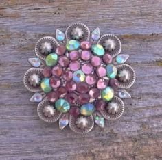 Not only can these beautiful conchos be used for tack, but would make a stunning necklace.   www.pamperedcowgirl.com