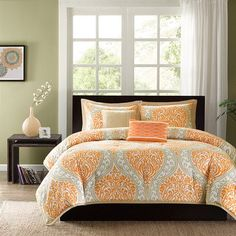 Pretty orange and gray bedding set.  Looking for Orange in a Bedroom? CLICK HERE