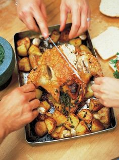 Roast chicken with lemon and rosemary roast potatoes