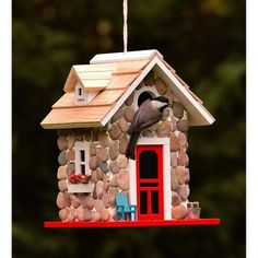 Plow & Hearth Stone Cottage Birdhouse Pine birdhouse with cedar shingles Stone siding Bold red door with white trim Adirondack out front Metal bucket with Fatwood Flowers in window boxes dia. opening Nylon cord for hanging sq. x plow and hearth Accents Decorative Bird Houses, Bird Houses Painted, Bird Houses Diy, Fairy Houses, Painted Birdhouses, Garden Houses, Hearth Stone, Stone Siding, Stone Cottages
