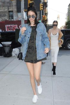 Kendall Jenner wearing Kenneth Cole Kam Sneakers, Elizabeth and James Watts Sunglasses in Black/Silver Mirror Lens, Givenchy Bow-Cut Mini Leather Crossbody Bag, Denim x Alexander Wang Daze Oversized Denim Jacket and Daniel Patrick Oversized Tee in Dark Camo