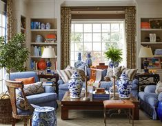 Mary MacDonald--love the big coffee table. I need one of these!!! Also love the fabric covered upholstered pieces--they make the room approachable.