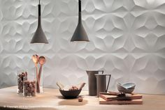 home 3-D WallDesign is a among the companies offering oversized ceramic tiles for decorative applications. The white-body tiles have a satin finish.