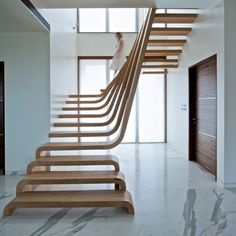 TrendsNow | Sculptural Wooden Staircase