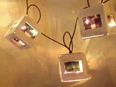 Repurposed slides into boxes for lights on a strand.