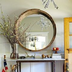 Buy a half barrel at your local home improvement center, cut it down to size, and then slot in a plain round mirror for a rustic addition to your home.