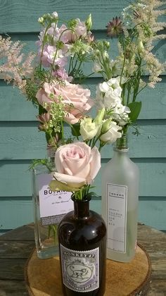 Flowers in gin bottles Wedding Table Centres, Wedding Table Flowers, Wedding Table Decorations, Wedding Chairs, Bottle Centerpieces, Flower Centerpieces, Flower Decorations, Wedding Centerpieces, Flower Arrangements