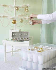 Protect your ornaments from damage- cut a piece of corrugated cardboard to line the bottom of a plastic storage bin. Then use a hot-glue gun to attach paper cups to the cardboard. Wrap ornaments in tissue paper, and place in cups. Then stack cardboard-and-cup flats inside the container. Store smaller ornaments in egg cartons.