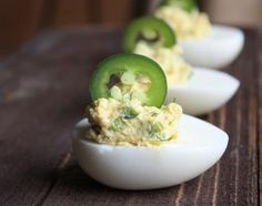 Jalapeno Deviled Eggs.. I'm going to use red and green jalapeños for the garnish/ filling. Perhaps bacon as well!