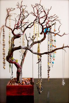 Miniature tree necklace organizer.
