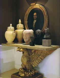 David Hicks vignette - wonderful gilt-framed portrait against dark walls