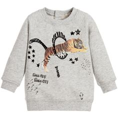 Stella McCartney Kids, grey sweatshirt, suitable for both baby boys and girls. Made in lightweight organically grown cotton with a sweatshirt jersey feel and a soft fleece inside. It has ribbed trims and fastens with poppers at the back to help with dressing. There is a coloured circus tiger print with velour details on the front. Great to wear with tracksuit trousers or jeans.   The Stella McCartney fit can be quite small so we advise you to choose a size up if you want room to grow.