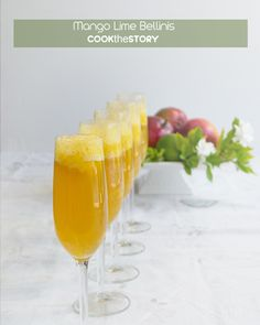 Mango Lime Bellinis are perfect for brunch or a cocktail party. Get the recipe on COOKtheSTORY.com