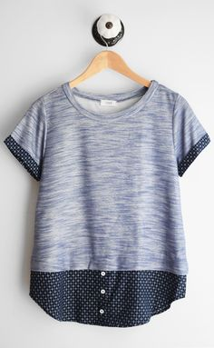 Navy short sleeve tee with jacquard contrast and rounded neckline. Fits true to size 65% Rayon, 35% Polyester