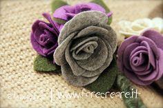 spilla in feltro viola e grigia.