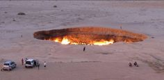 """A picture taken on May shows people visiting """"The Gateway to Hell,"""" a huge burning gas crater in the heart of Turkmenistan's Karakum desert. The fiery pit was the result of a simple. Attraction, Continents And Oceans, Monte Fuji, Natural Phenomena, Photos Of The Week, What Is Like, Traveling By Yourself, The Good Place, Around The Worlds"""