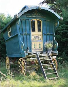 Love the curvy wood cutouts on the side of the caravan - white decorative door with lots of blue!
