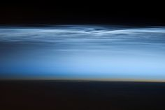 """Polar mesospheric clouds—also known as noctilucent or """"night shining"""" clouds—form between 76 to 85 kilometers (47 to 53 miles) above the Earth's surface, near the boundary of the mesosphere and thermosphere, a region known as the mesopause. At these altitudes, water vapor can freeze into clouds of ice crystals. When the Sun is below the horizon and the ground is in darkness, these high clouds may still be illuminated, lending them their ethereal, """"night shining"""" qualities."""