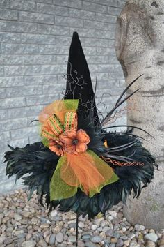 A fashionable favorite amount witch hat fans…the iridescent feathers will frame your face as well as accent the beautiful embellishments. BlackRidged Velvet19