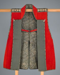 Warrior's surcoat (jinbaori)  19th century,Edo period, Japan  Brushed wool, silk brocade, silk with silver-leaf paper supplementary weft patterning, silk chirimen, silk cord, stencil-dyed leather, and gilded leather