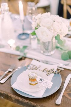 How adorable are these mini honey wedding favors? This rustic reception came together so beautifully thanks to this bride and grooms entire community! You would never believe the trials and tribulations it took to get there-  were sharing the full story on stylemepretty.com!  Photographer: @emilyerutledge  #weddingfavors #honeyweddingfavors #rusticwedding #rusticreception #farmwedding #receptioninspiration