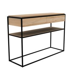 A perfect fit for the modern home, the striking aesthetics of this Monolit Console Table are sure to add an elegance and refinement to your interior space. The contemporary geometric square metal frame embraces the light oak creating a piece of furniture that is minimalist in style but with a solid practical functionality. It features two drawers to keep all your items neatly concealed and a shelf underneath for additional storage.