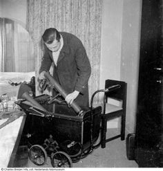 Dutch resistance member hiding rocket launchers in a baby carriage for transport, Amsterdam 1945  [[MORE]] Here is also a picture of how it would look with a baby in it on top of the weapons
