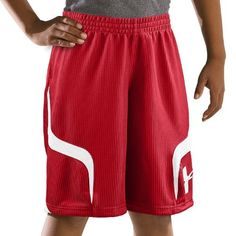 """Boys' Valkyrie 10"""" Basketball Shorts Bottoms by Under Armour Youth Large Red by Under Armour. $19.99. Durable, soft dazzle fabric delivers unrivaled comfort and a sleek swagger. Signature Moisture Transport System wicks sweat away from the body, keeping you cool, dry, and focused. 2.5"""" stretch waistband with internal drawcord delivers a secure, comfortable fit. Speed-inspired contrast side panels look as fast and fierce on and of the court. Oversized twill heat seal UA log..."""