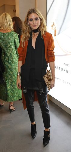 At a London Fashion Week dinner, the style setter peeled her overalls down to her waist and topped the look with a black blouse and skinny scarf. How's that for innovative?