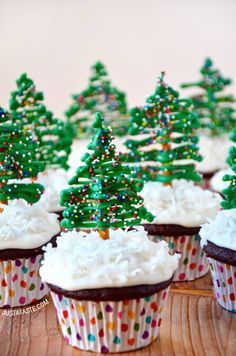 """These edible cake toppers (made of melted candy, pretzel sticks and sprinkles) are so pretty, but you know they're even tastier...  Throw them on top of just about any cupcake flavor (here, the blogger used chocolate cupcakes with cream cheese frosting and a dusty of shredded coconut """"snow) for a dessert that's sure to get your friends and family in the Christmas spirit. Click through for this and more Christmas cupcake recipes. Cupcake Art, Cupcake Cakes, Holiday Recipes, Holiday Ideas, Christmas Recipes, Christmas Time, Holy Night, Snow Days, Cupcakes With Cream Cheese Frosting"""