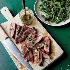 Flank Steak with Herb Dressing and Charred Broccolini | MyRecipes.com Adding the steak's juices into the dressing it's served with boosts savory satisfaction.