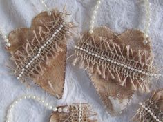 Rustic Christmas ornaments  https://www.etsy.com/listing/255012604/set-of-4-coffee-dyed-canvas-hearts