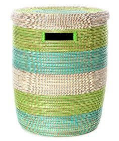 This beautiful medium aqua, green, and white stripe Peace Corps laundry hamper is handcrafted by a network of more than 100 rural Wolof women in Senegal, West Africa. Named after the Peace Corps volun