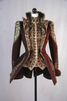 Jacket made of heavy wool in wine and cream. Tight fitting, hip-length jacket with stand-up collar. Front attached vest is ornately trimmed with maroon machine embroidery. The same trim is found on the shoulder, bottom of sleeve and on the back. Skirt of the jacket is shaped to fit over a bustle. c. 1890s.