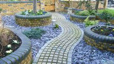 Granite setts create a rustic looking pathway, the plum paddlestones provide vibrant colour in this garden design. Driveway Entrance, Stone Path, Rustic Colors, Patio, Rustic Design, Pathways, Beautiful Landscapes, Natural Stones, Granite