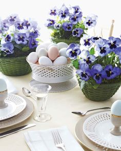 Pansies appear to bloom out of these baskets, chosen to complement the plates on an Easter table.