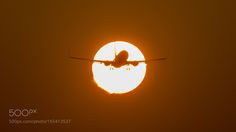 Suncross by an airplane by DennisDieleman