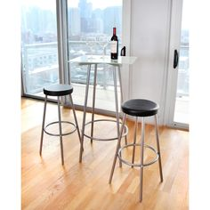 This contemporary three-piece set includes a glamorous glass top bar table and two bar stools with sturdy metal legs and footrests. Ideal for entertaining and everyday use, this multi-functional set includes everything you need to get started.