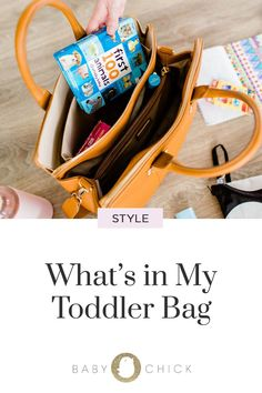 I'm opening my purse and showing everything I carry inside my toddler bag. See what I bring with me to care for and entertain my tot.