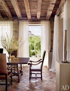 Love the floors and the light airy curtains.