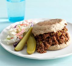 Spicy Hot Sloppy Joes.    Seasoned ground beef and tomato sauce are served on English muffins to make these dinner sandwiches.