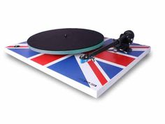 Vinyl is making a comeback! If you don't own a quality turntable, you might take a look at Rega's RP3 custom Union Jack edition.