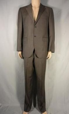 Desperate Housewives        This unique item is from the television show Desperate Housewives.    This is Carlos Solis' screen worn stunt wardrobe item.        Season:  Not Specified    Episode Title:  Not Specified         Items: Single Breasted Suit      Wardrobe Details          SUIT (STUNT)   Brand: Abito Sartoriale      Size: Blazer: 54 / Pants: Approx. 38X32      Material: Wool      Color: Brown