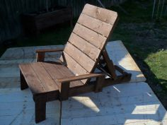 A Rustic Reclining Garden Sunlounger made from recycled pallets. It has two arm rests added for comfort and can be adjusted from a sitting to a lounging position for those lazy sunny afternoons.